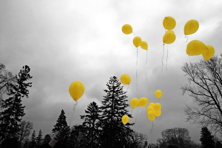 Yellow balloons in sky